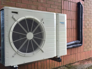Air source heat pumps look similar to small air conditioning units